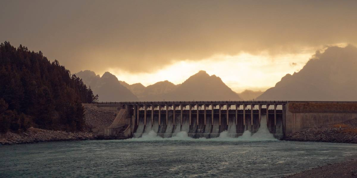 hydro electric dam with mountains in background