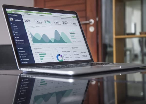 laptop on office table with website analytics showing