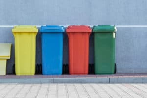 orderly colored garbage cans